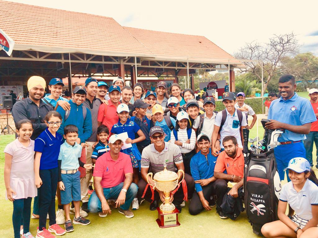 An elated Viraj surrounded by a group of excited children at the Karnataka Golf Association after the win.