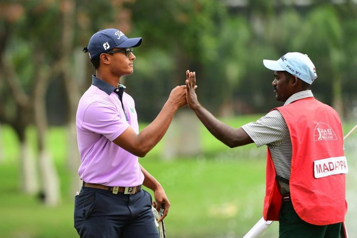 Viraj Madappa celebrates with his caddie after breaking through on the Asian Tour with the win at the 2018 Take Solutions Masters in Bangalore.