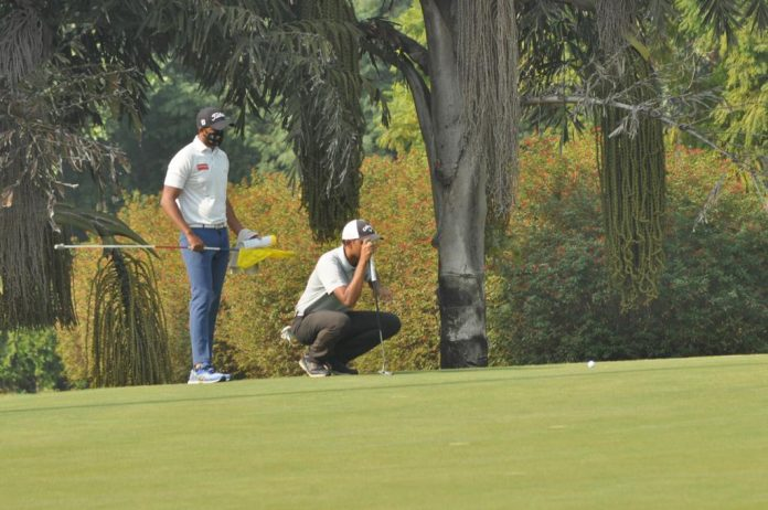 Veer Ahlawat was prolific on the greens of the Delhi Golf Club on Wednesday. The 7-under 65 got him a share of second spot going into the third day of the PGTI MP Cup. Photo: Veer Ahlawat